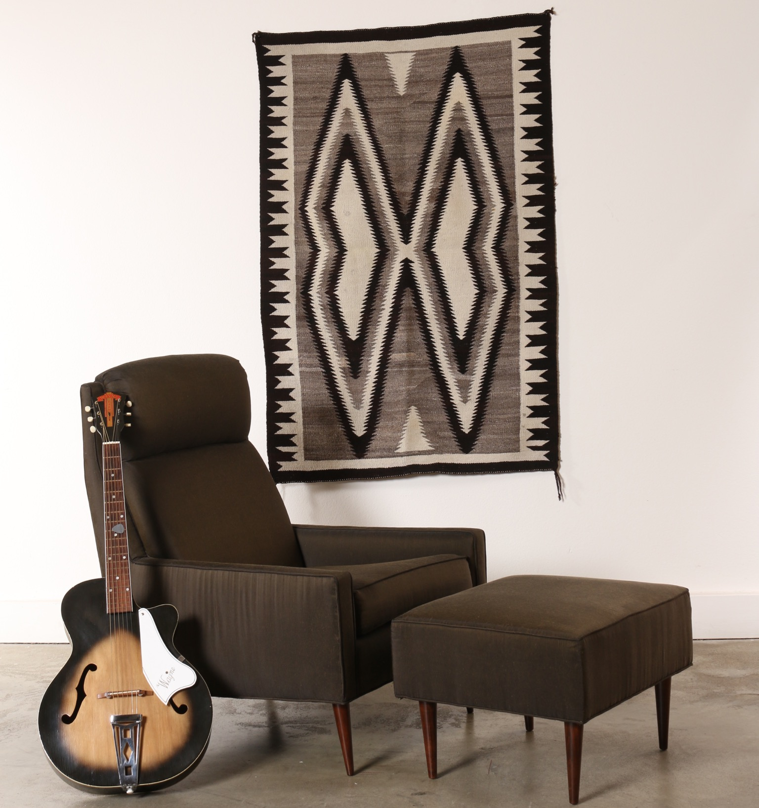 lounge chair, rug and guitar